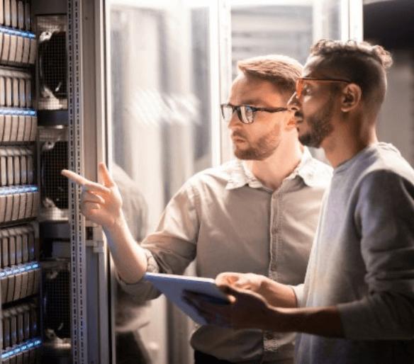 two-men-watching-a-server-rack-v
